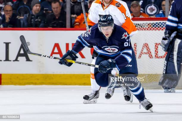Nelson Nogier of the Winnipeg Jets follows the play down the ice during second period action against the Philadelphia Flyers at the MTS Centre on...