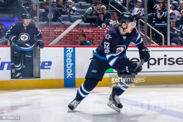 Nelson Nogier of the Winnipeg Jets hits the ice prior to puck drop in his NHL debut against the Philadelphia Flyers at the MTS Centre on March 21...