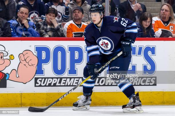 Nelson Nogier of the Winnipeg Jets keeps an eye on the play during second period action against the Philadelphia Flyers at the MTS Centre on March 21...