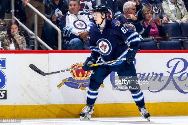 Nelson Nogier of the Winnipeg Jets keeps an eye on the play during second period action against the Nashville Predators at the MTS Centre on April 8...