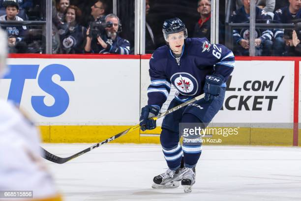 Nelson Nogier of the Winnipeg Jets keeps an eye on the play during third period action against the Nashville Predators at the MTS Centre on April 8...