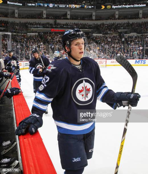 Nelson Nogier of the Winnipeg Jets looks on during a second period stoppage in play against the Nashville Predators at the MTS Centre on April 8 2017...