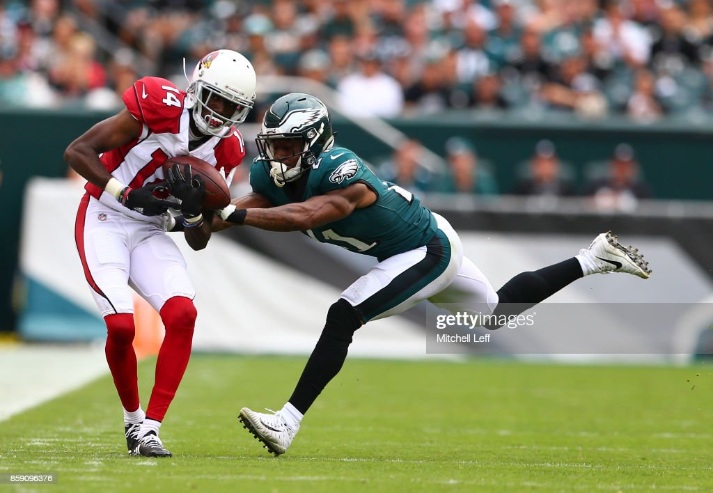 J.J. Nelson #14 of the Arizona Cardinals catches a pass against Patrick Robinson #21 of the Philadelphia Eagles in the third quarter at Lincoln Financial Field on October 8, 2017 in Philadelphia, Pennsylvania. The Eagles defeated the Cardinals 34-7.