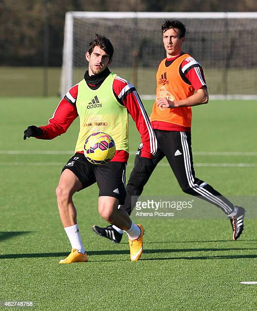 Nelson Oliveira controls the ball in front of Federico Fernandez during a Swansea City training session at Fairwood training ground on February 4...