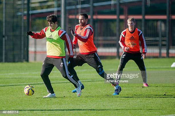 Nelson Oliveira is chased by Kyle Bartley during the Swansea City Training Session on January 21 2015 in Swansea Wales