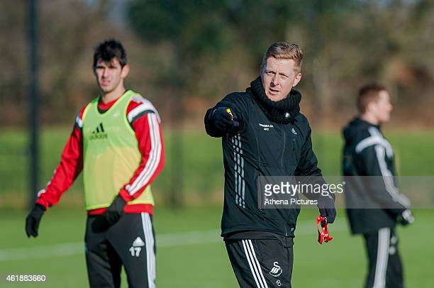 Nelson Oliveira looks on as manager Garry Monk gives instructions during the Swansea City Training Session on January 21 2015 in Swansea Wales
