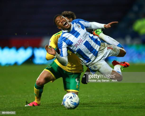 Nelson Oliveira of Norwich City and Rajiv Van La Parra of Huddersfield Town during the Sky Bet Championship match between Huddersfield Town and...