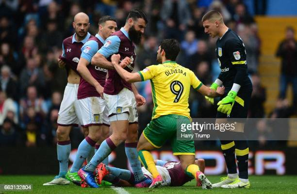 Nelson Oliveira of Norwich City clashed with Mile Jedinak of Aston Villa during the Sky Bet Championship match between Aston Villa and Norwich City...