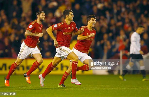 Nelson Oliveira of Nottingham Forest celebrates with team mates as he scores their first goal during the Sky Bet Championship match between...