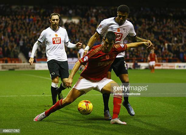 Nelson Oliveira of Nottingham Forest holds off Cyrus Christie of Derby County during the Sky Bet Championship match between Nottingham Forest and...