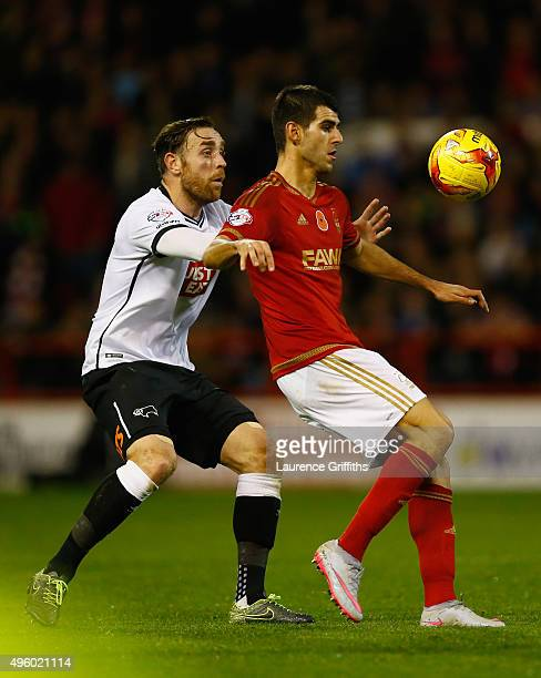 Nelson Oliveira of Nottingham Forest holds off Richard Keogh of Derby County during the Sky Bet Championship match between Nottingham Forest and...