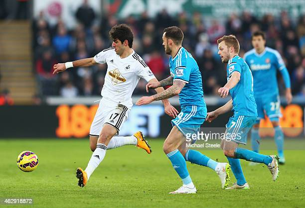 Nelson Oliveira of Swansea City is closed down by Steven Fletcher and Sebastian Larsson of Sunderland during the Barclays Premier League match...