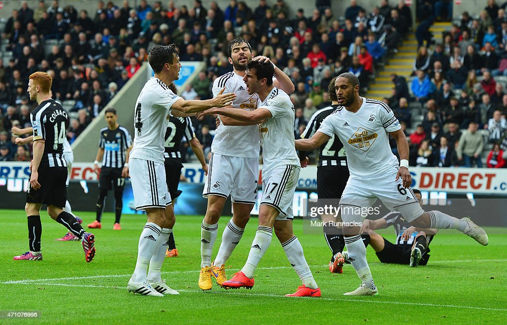 Nelson Oliveria of Swansea City (2R)celebrates scoring their first goal with team mates during the Barclays Premier League match between Newcastle United and Swansea City at St James' Park on April 25, 2015 in Newcastle upon Tyne, England.