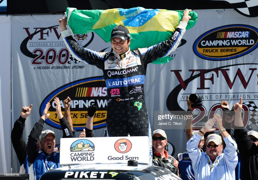 Nelson Piquet Jr driver of the Autotrac Chevrolet celebrates in Victory Lane after winning the NASCAR Camping World Truck Series VFW 200 at Michigan...