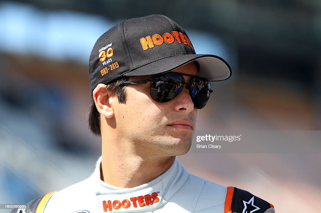 <a gi-track='captionPersonalityLinkClicked' href=/galleries/search?phrase=Nelson+Piquet+Jr.+-+Born+1985&family=editorial&specificpeople=235640 ng-click='$event.stopPropagation()'>Nelson Piquet Jr.</a>, driver of the #30 Hooters Chevrolet, stands on the grid during qualifying for the NASCAR Nationwide Series Dollar General 300 Powered by Coca-Cola at Chicagoland Speedway on September 14, 2013 in Joliet, Illinois.