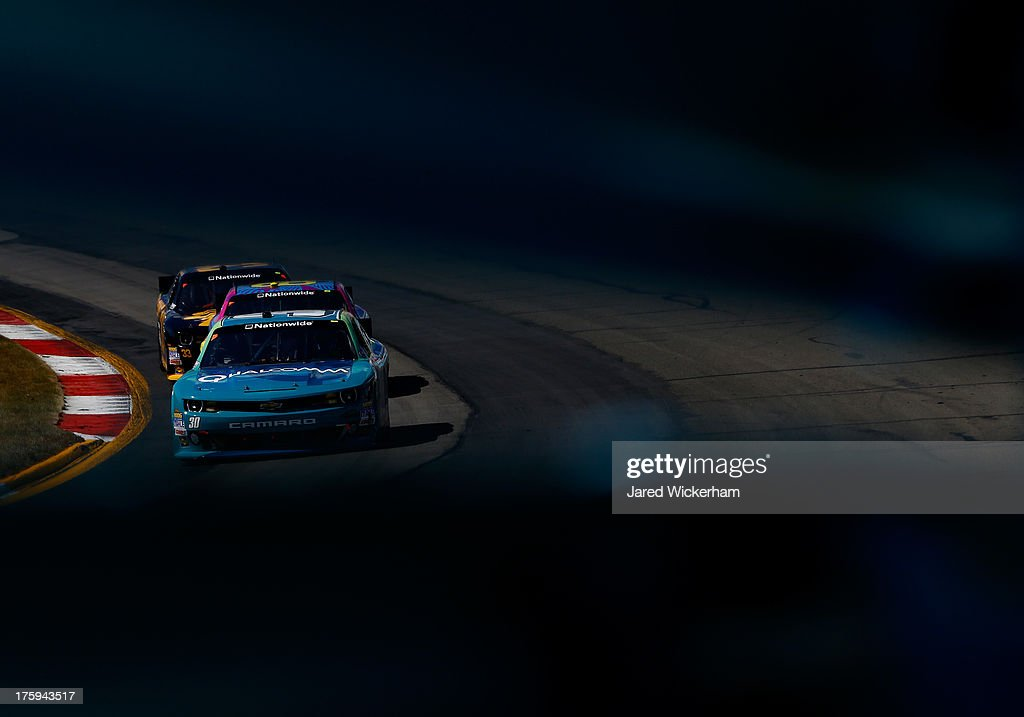 Nelson Piquet Jr., driver of the #30 Qualcomm Chevrolet, drives during the NASCAR Nationwide Series Zippo 200 at Watkins Glen International on August 10, 2013 in Watkins Glen, New York.