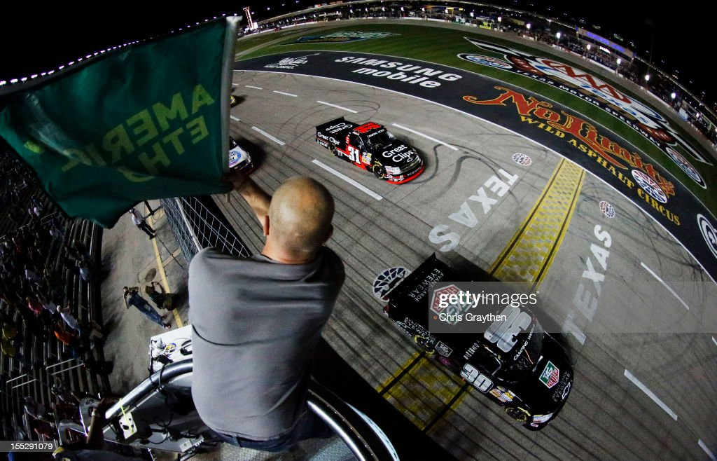 Nelson Piquet Jr driver of the TAG Heuer AvantGarde Eyewear Chevrolet leads the field to the start of the NASCAR Camping World Truck Series WinStar...