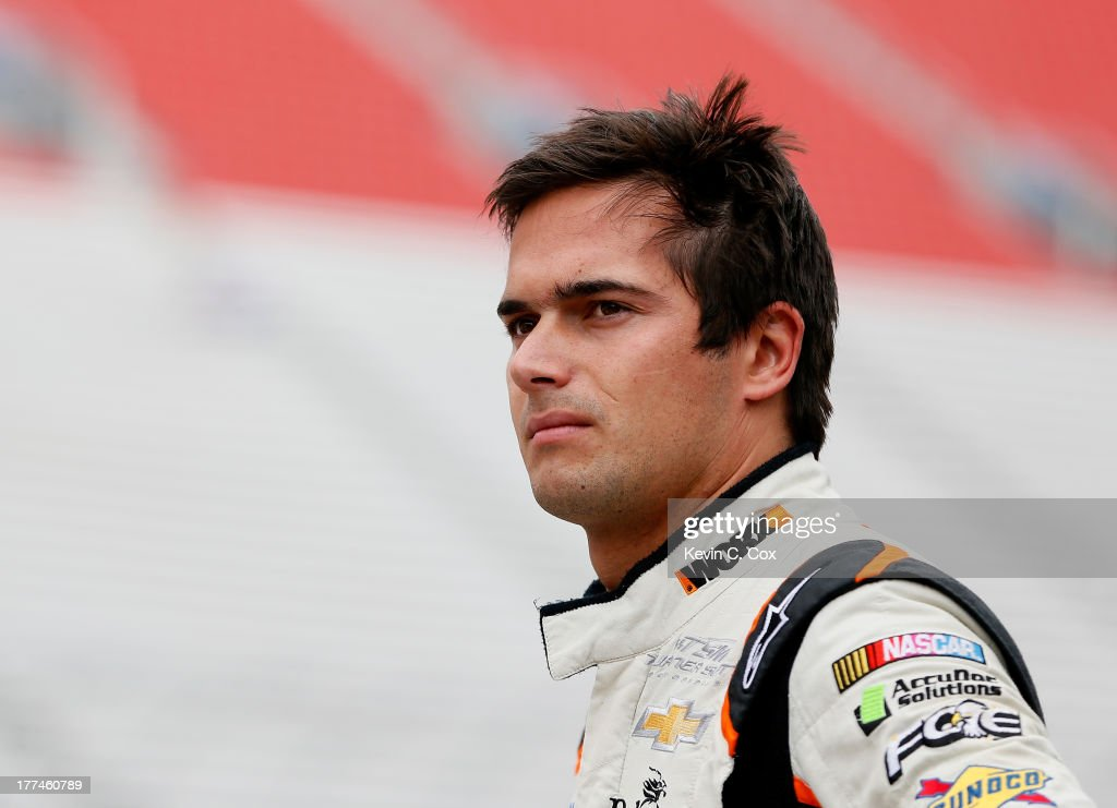 Nelson Piquet Jr driver of the WORX Chevrolet looks on in the garage area during practice for the NASCAR Nationwide Series Food City 250 at Bristol...