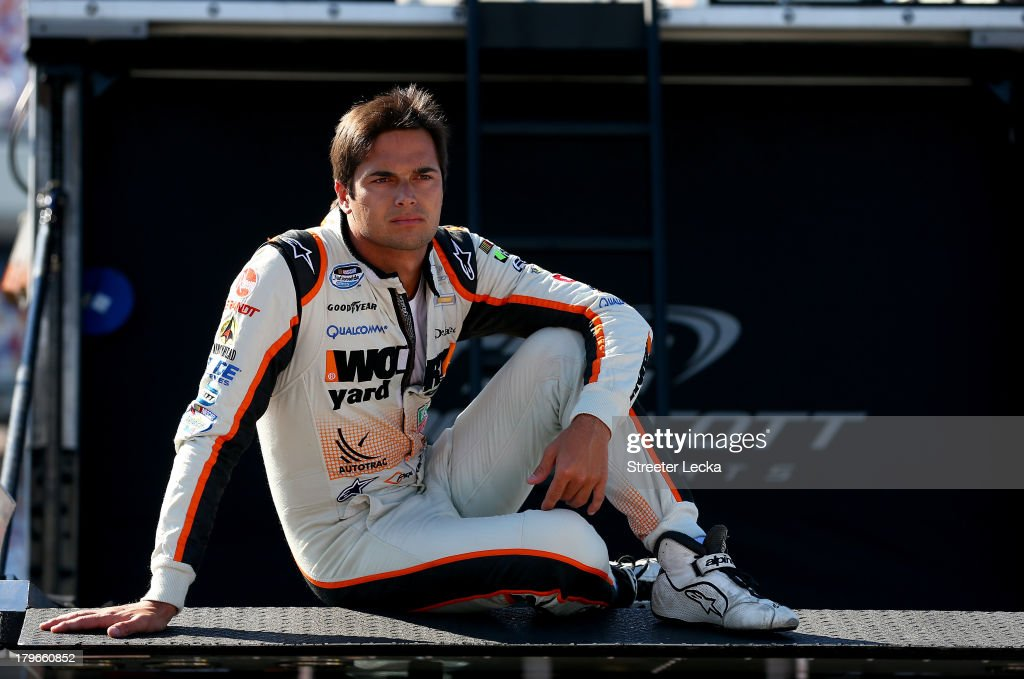 Nelson Piquet Jr driver of the WORX Chevrolet sits in the garage area during practice for the NASCAR Nationwide Series Virginia 529 College Savings...