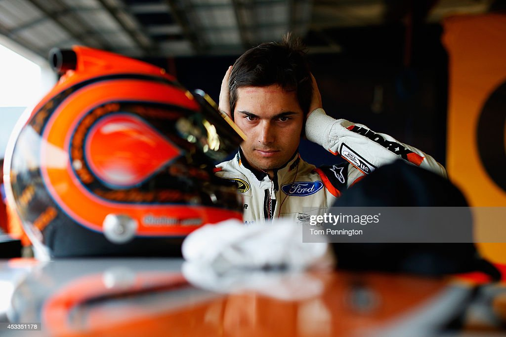 Nelson Piquet Jr driver of the WORX Ford prepares his equipment in the garage area during practice for the NASCAR Sprint Cup Series CheezIt 355 at...