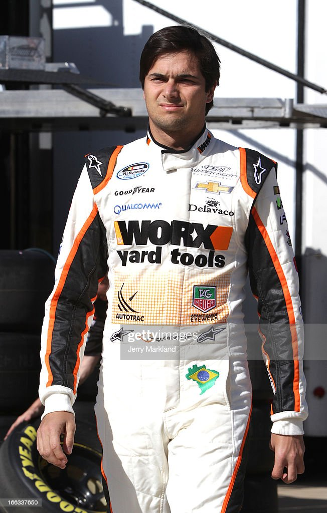 Nelson Piquet Jr driver of the Worx Yard Tools Chevrolet stands in the garage area during practice for the NASCAR Nationwide Series O'Reilly Auto...