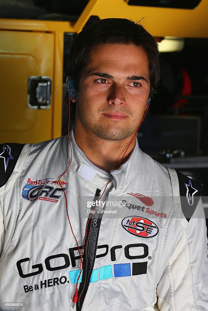 Nelson Piquet Jr, driver of the #5 Zaxby's Toyota waits in the garage during practice for the NASCAR Camping World Truck Series Drivin' for Linemen 200 at Gateway Motorsports Park on June 13, 2014 in Madison, Illinois.