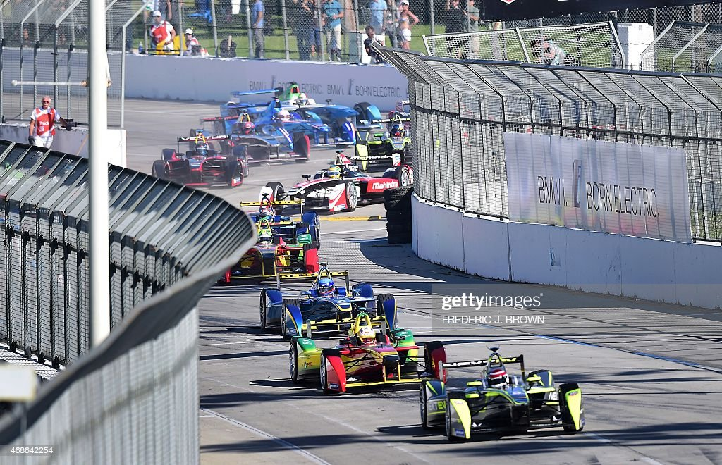 Nelson Piquet Jr leads the pack during the inaugural Formula E Long Beach ePrix race in Long Beach California on April 4 2015 as the city hosted...