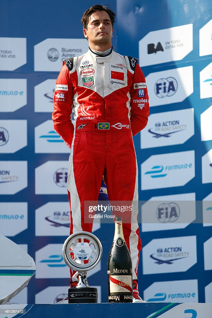 Nelson Piquet Jr of Brazil and China Racing Formula E Team poses at the podium after the 2015 FIA Formula E Buenos ePrix at Puerto Madero Street Race...