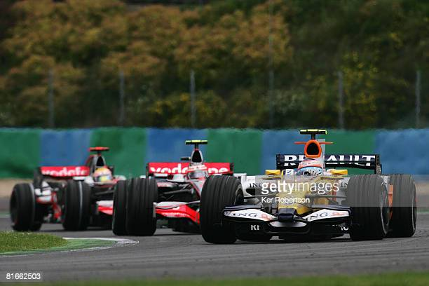 Nelson Piquet of Brazil and Renault leads a group of cars during the French Formula One Grand Prix at the Circuit de Nevers MagnyCours on June 22...