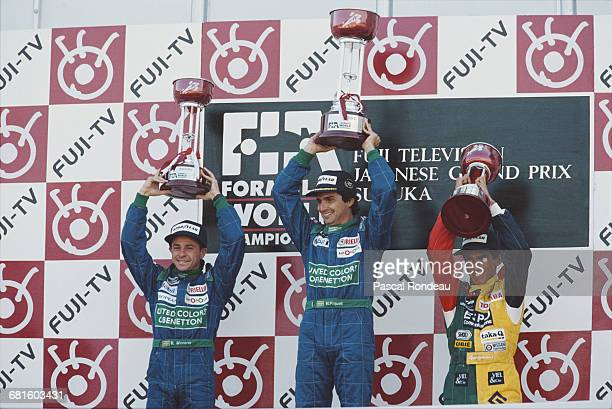 Nelson Piquet of Brazil driver of the Benetton Formula Benetton B189B Ford V8 celebrates with second placed team mate Roberto Moreno and third placed...