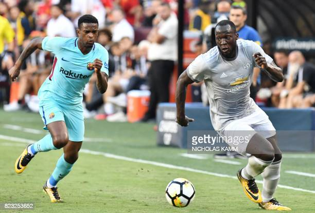 Nelson Semedo of Barcelona and Romelu Lukaku of Manchester United chase the ball during their International Champions Cup football match on July 26...