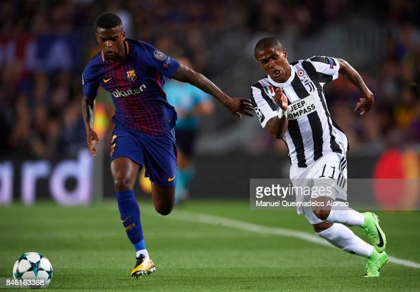 Nelson Semedo of Barcelona competes for the ball with Douglas Costa of Juventus during the UEFA Champions League group D match between FC Barcelona...