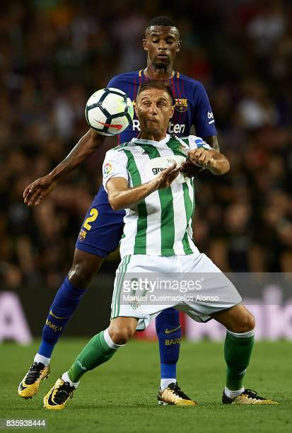 Nelson Semedo of Barcelona competes for the ball with Joaquin Sanchez of Betis during the La Liga match between Barcelona and Real Betis at Camp Nou...