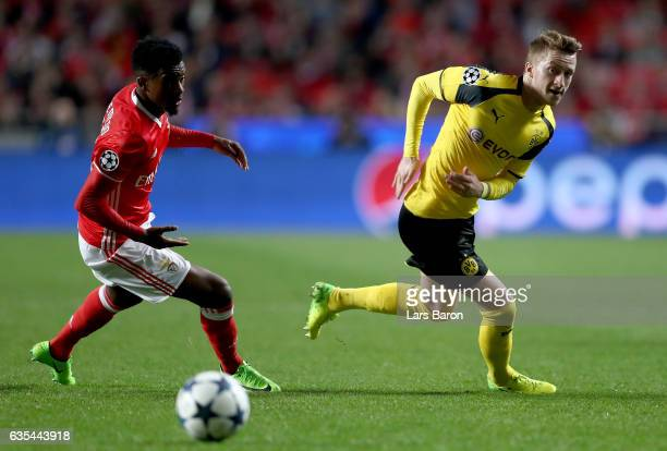 Nelson Semedo of Benfica challenges Marco Reus of Dortmund during the UEFA Champions League Round of 16 first leg match between SL Benfica and...
