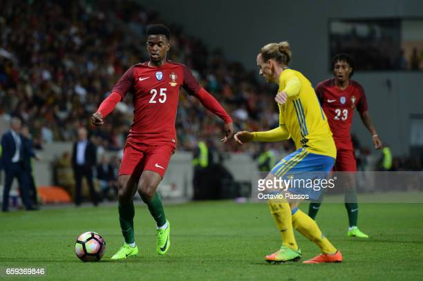 Nelson Semedo of Portugal competes for the ball with Niklas Hult of Sweden during the International friendly match between Portugal and Sweden at...