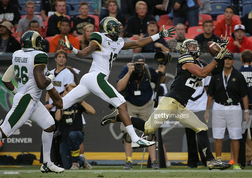 Nelson Spruce of the Colorado Buffaloes eludes DeAndre Elliott of the Colorado State Rams to catch a 54 yard touchdown pass from Sefo Liufau of the...