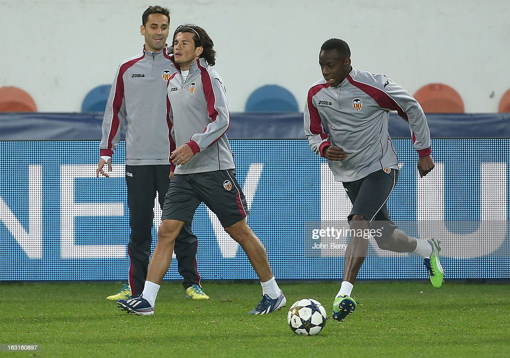 PARIS, FRANCE - MARCH Nelson Valdez (C) and Aly Cissokho (R) of Valencia warm up during the training session on the eve of the Champions League match between Paris Saint Germain FC and Valencia CF at the Parc des Princes stadium on March 5, 2013 in Paris, France.