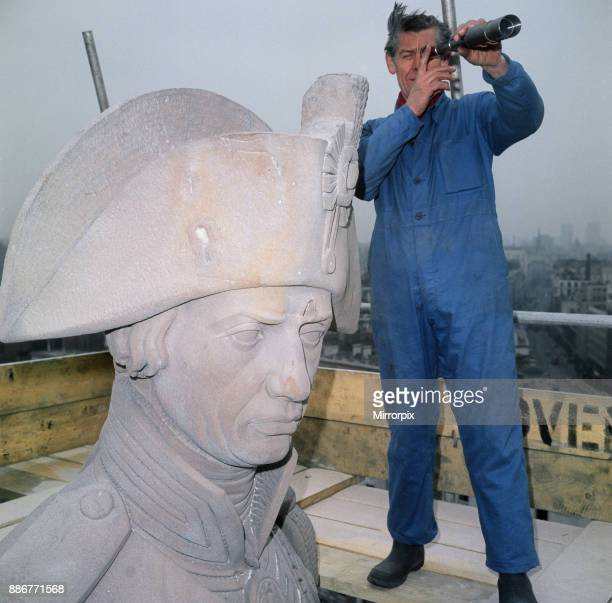 Nelson's Column being cleaned Cleaner Ted Chambers taking a break to survey the landscape of London through a telescope Trafalgar Square London 2nd...