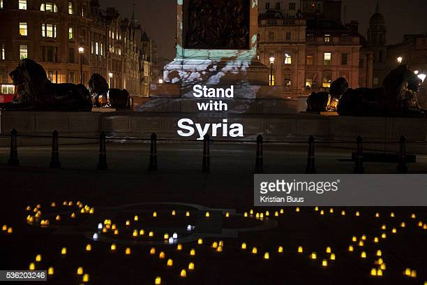 Nelson's column in Trafalgar Square in London is lit up with art work by Banksy as part of a vigil to to launch the Stand with Syria campaign The...