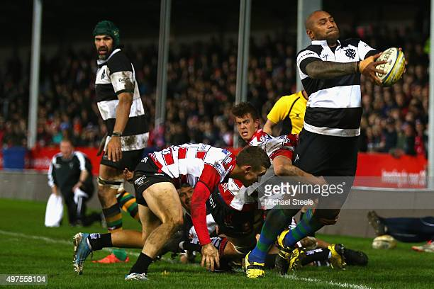 Nemani Nadalo of Barbarians throws the ball backwards to keep it alive as Steph Reynolds of Gloucester challenges during the Gloucester v Barbarians...