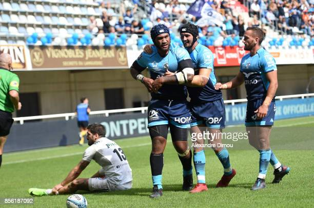 Nemani Nadolo celebrates with Alexandre Dumoulin and Aaron Cruden during the Top 14 match between Montpellier and Brive at on October 1 2017 in...
