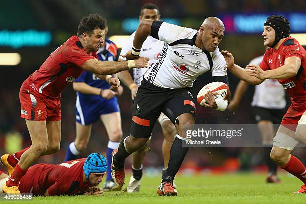 Nemani Nadolo of Fiji powers his way past Mike Phillips and Nicky Smith of Wales during the International match between Wales and Fiji at the...