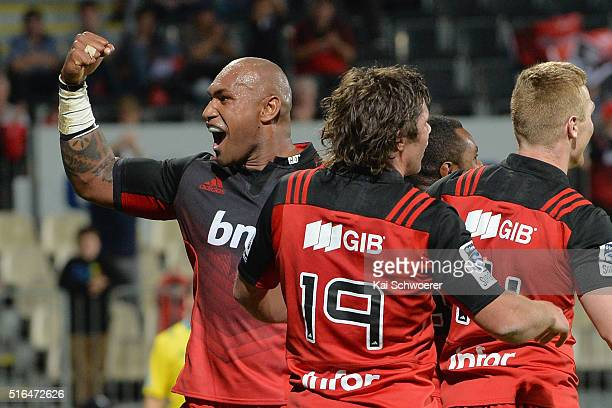 Nemani Nadolo of the Crusaders celebrates with team mates after Jone Macilai scores a try during the round four Super Rugby match between the...