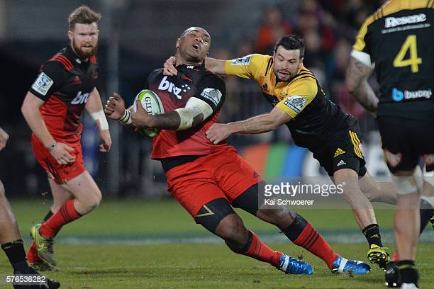 Nemani Nadolo of the Crusaders is tackled by James Marshall of the Hurricanes during the round 17 Super Rugby match between the Crusaders and the...