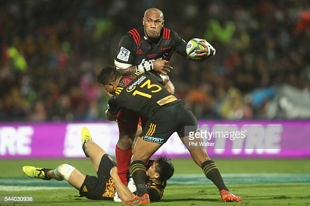 Nemani Nadolo of the Crusaders is tackled by Seta Tamanivalu of the Chiefs during the round 15 Super Rugby match between the Chiefs and the Crusaders...