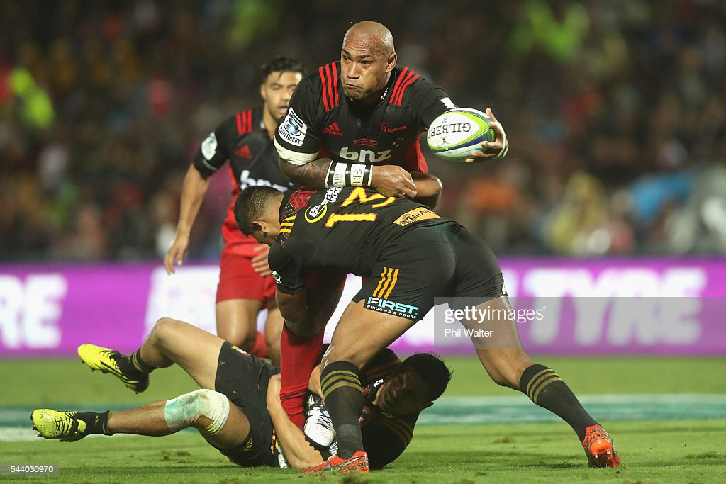 <a gi-track='captionPersonalityLinkClicked' href=/galleries/search?phrase=Nemani+Nadolo&family=editorial&specificpeople=6547098 ng-click='$event.stopPropagation()'>Nemani Nadolo</a> of the Crusaders is tackled by <a gi-track='captionPersonalityLinkClicked' href=/galleries/search?phrase=Seta+Tamanivalu&family=editorial&specificpeople=9743583 ng-click='$event.stopPropagation()'>Seta Tamanivalu</a> of the Chiefs during the round 15 Super Rugby match between the Chiefs and the Crusaders at ANZ Stadium on July 1, 2016 in Suva, Fiji.