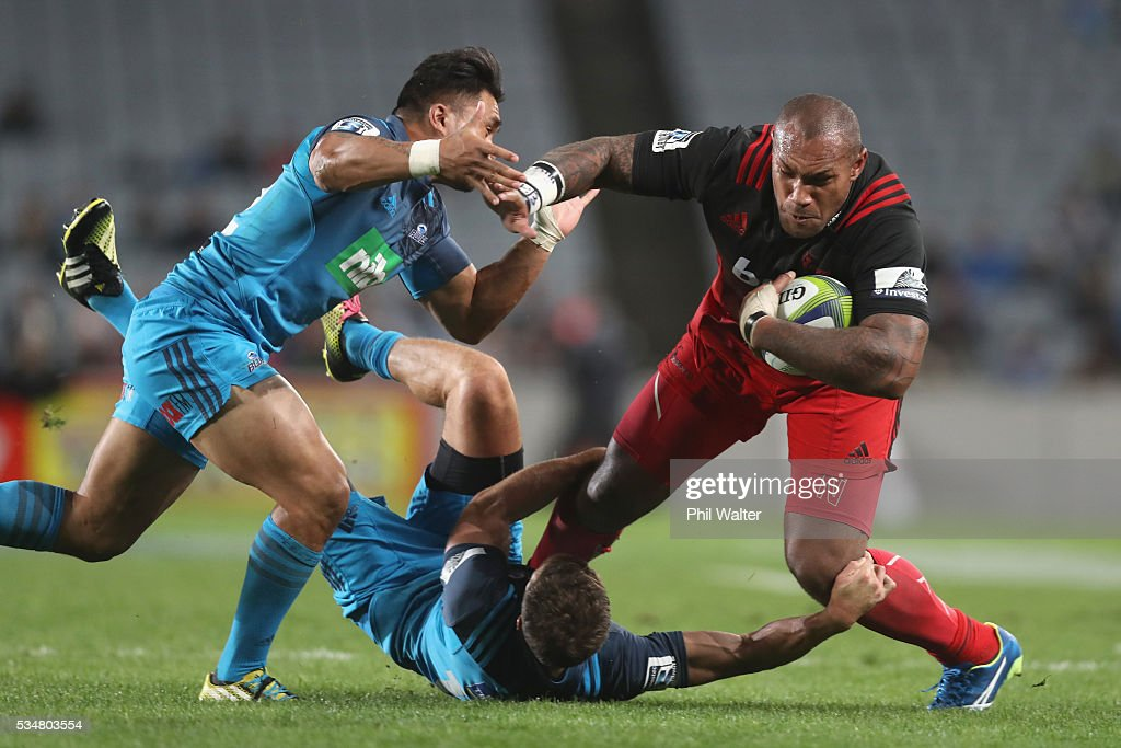 <a gi-track='captionPersonalityLinkClicked' href=/galleries/search?phrase=Nemani+Nadolo&family=editorial&specificpeople=6547098 ng-click='$event.stopPropagation()'>Nemani Nadolo</a> of the Crusaders is tackled during the round 14 Super Rugby match between the Blues and the Crusaders at Eden Park on May 28, 2016 in Auckland, New Zealand.