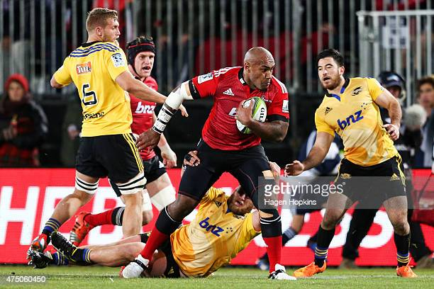 Nemani Nadolo of the Crusaders is tackled during the round 16 Super Rugby match between the Crusaders and the Hurricanes at Trafalgar Park on May 29...