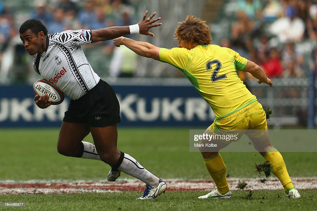Nemani Nagusa of Fiji makes a break during the cup quarter final match between Australia and Fiji on day three of the 2013 Hong Kong Sevens at Hong Kong Stadium on March 24, 2013 in So Kon Po, Hong Kong.