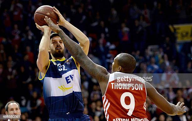 Nemanja Aleksandrov of Oldenburg is challenged by Deon Thompson of Muenchen during the match between FC Bayern Muenchen and EWE Baskets Oldenburg at...